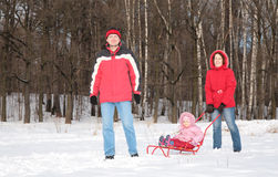 Parents and child on sled Stock Image