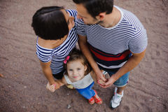 Parents with child stand having joined hands Stock Images