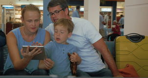 Parents and child using digital tablet at the stock video footage