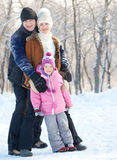 Parents with child walking in a winter park Stock Image
