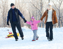 Parents with child walking in a winter park Royalty Free Stock Photo