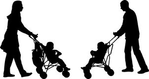 Parents and children. Young parents pushing strollers silhouettes Royalty Free Stock Photo