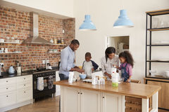 Parents And Children Baking Cakes In Kitchen Together Royalty Free Stock Photography