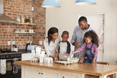 Parents And Children Baking Cakes In Kitchen Together stock photos