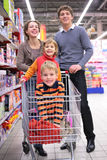 Parents with children in cart Royalty Free Stock Photos