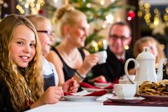 Family having traditional Christmas coffee time Stock Photography