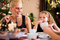 Family drinking traditional Christmas coffee Stock Images