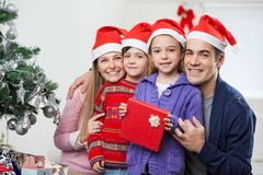 Parents And Children With Christmas Gift Royalty Free Stock Images