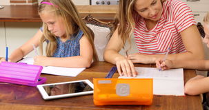 Parents and children doing homework together. In slow motion stock footage