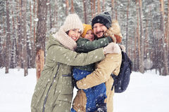 Parents and children embracing each other and enjoying holidays Stock Photography
