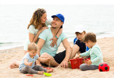Parents with children enjoying rest Stock Image