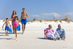 Parents Children & Grandparents Family on Beach royalty free stock image