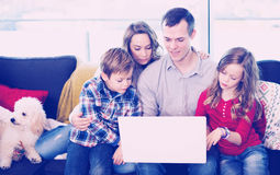 Parents and children happy to watch movie royalty free stock photos