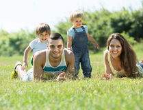 Parents with children laying in the grass Stock Photography