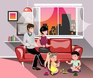 Parents with children in living room Stock Images