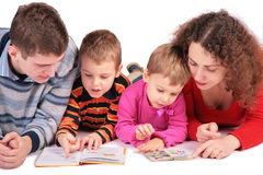 Parents with children look books 2 Stock Photos