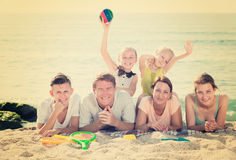 Parents with children lying on sand Royalty Free Stock Photo