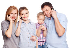Parents with children with mobile phone Royalty Free Stock Images