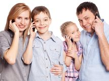 Parents with kids with mobile phone Royalty Free Stock Images