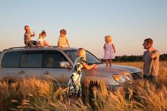 Parents and children on offroad car on wheaten fie Stock Image