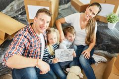 Parents and children with picture of the home royalty free stock images