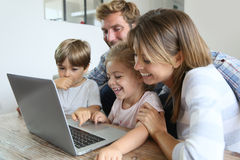 Parents with children playing on laptop Royalty Free Stock Image