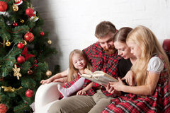 Parents and children reading stories together. Royalty Free Stock Photos