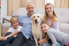 Parents and children on rug with labrador Royalty Free Stock Photo