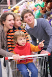 Parents with children in shop Stock Photos