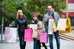Parents with children shopping in city Stock Images