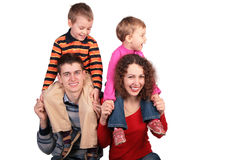 Parents with children on shoulders Royalty Free Stock Images