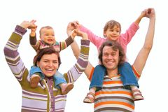 Parents with children on shoulders Stock Photos