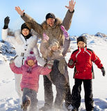 Parents and children on snow Stock Photo