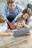 Parents and children spending time together at home Stock Images