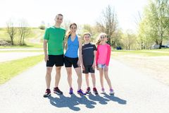 Parents with children sport running together outside. The Parents with children sport running together outside royalty free stock photos