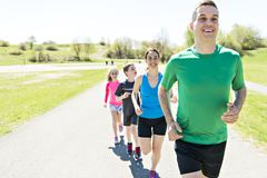 Parents with children sport running together outside. The Parents with children sport running together outside stock photos