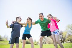 Parents with children sport running together outside. The Parents with children sport running together outside royalty free stock photography