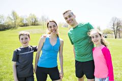 Parents with children sport running together outside. The Parents with children sport running together outside stock images