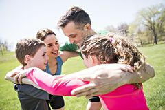 Parents with children sport running together outside. The Parents with children sport running together outside stock image