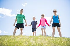 Parents with children sport running together outside. The Parents with children sport running together outside royalty free stock photo