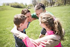 Parents with children sport running together outside. The Parents with children sport running together outside stock photography