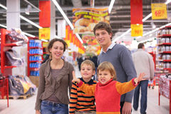 Parents with children in supermarket Stock Photo