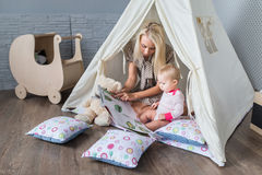 Parents with children in a teepee stock photography