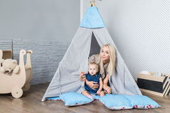 Parents with children in a teepee stock image