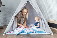 Parents with children in a teepee stock photos