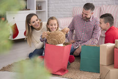 Parents and children unpacking presents Royalty Free Stock Photo