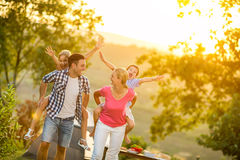 Parents and children on vacation playing together. Outdoor Royalty Free Stock Photos