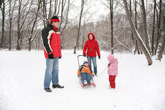Parents with children walk in the park Stock Images