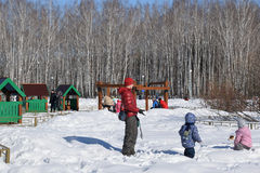 Parents with children are walking in the winter park. stock image