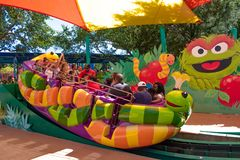 Parents and childs having fun at Slimey`s Slider in Sesame Street area at Seaworld in International Drive area  2 stock photos